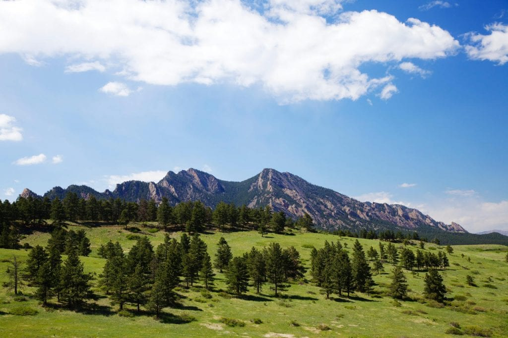 A green spring view of the Flatirons in Boulder, Colorado.