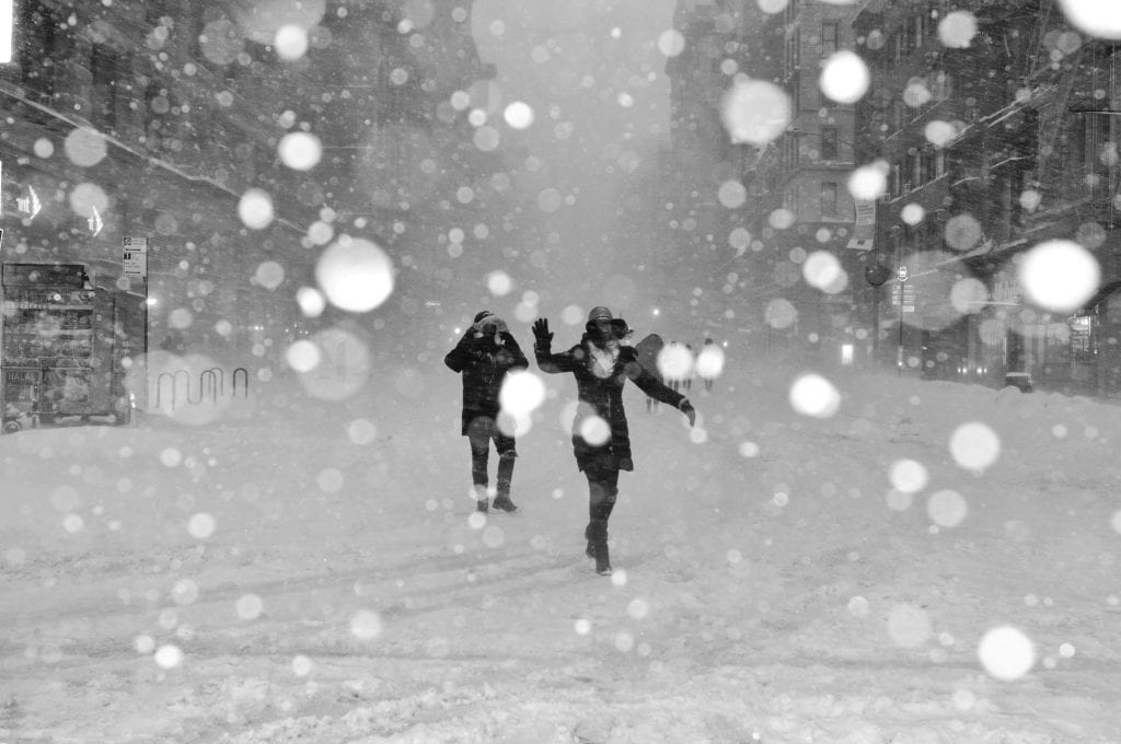 (people walking on snow covered street with bokeh effects photo)