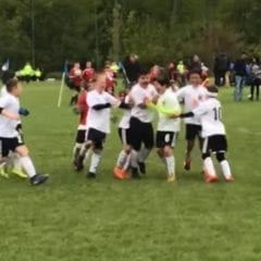 EMSSC Spartans celebrating the shootout win that sent them into the top 10 in Illinois.